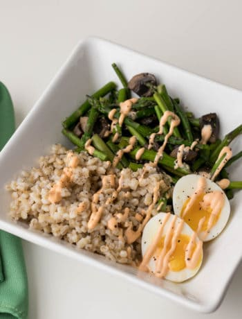parmesan pearl barley grain bowl with asparagus and eggs