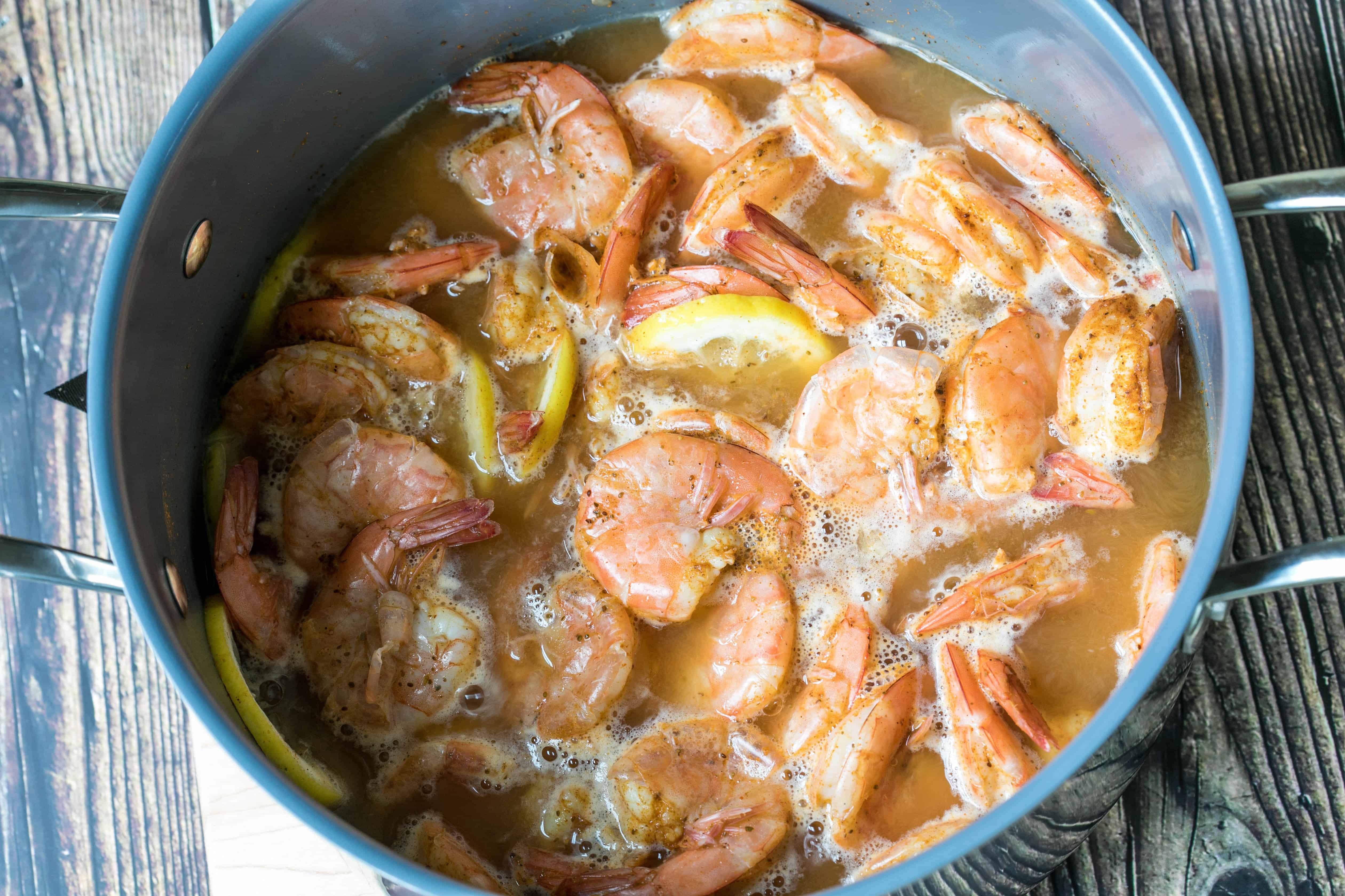 pot of shrimp with lemon, beer, cider vinegar, and old bay