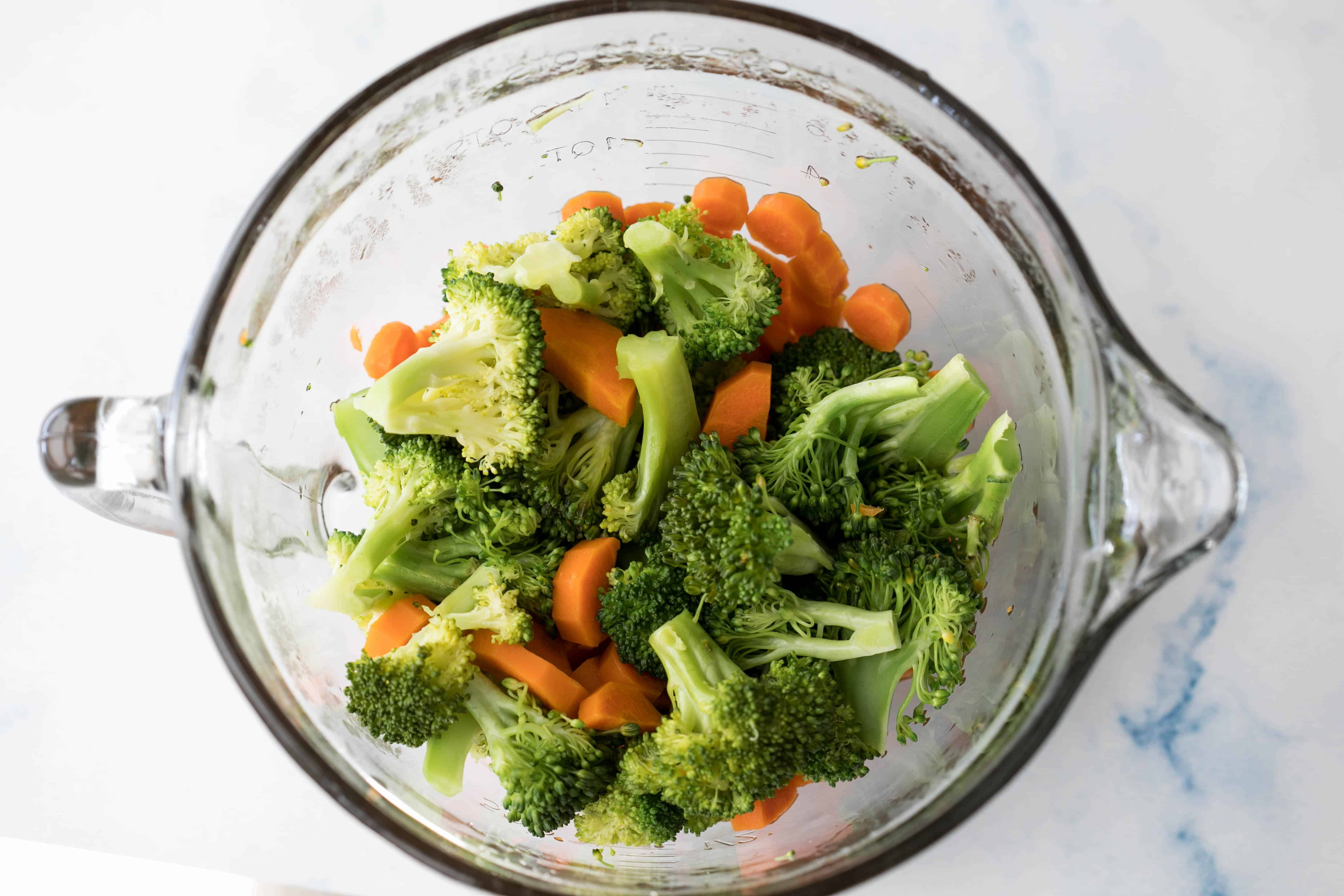 steamed broccoli and carrots in glass batter bowl