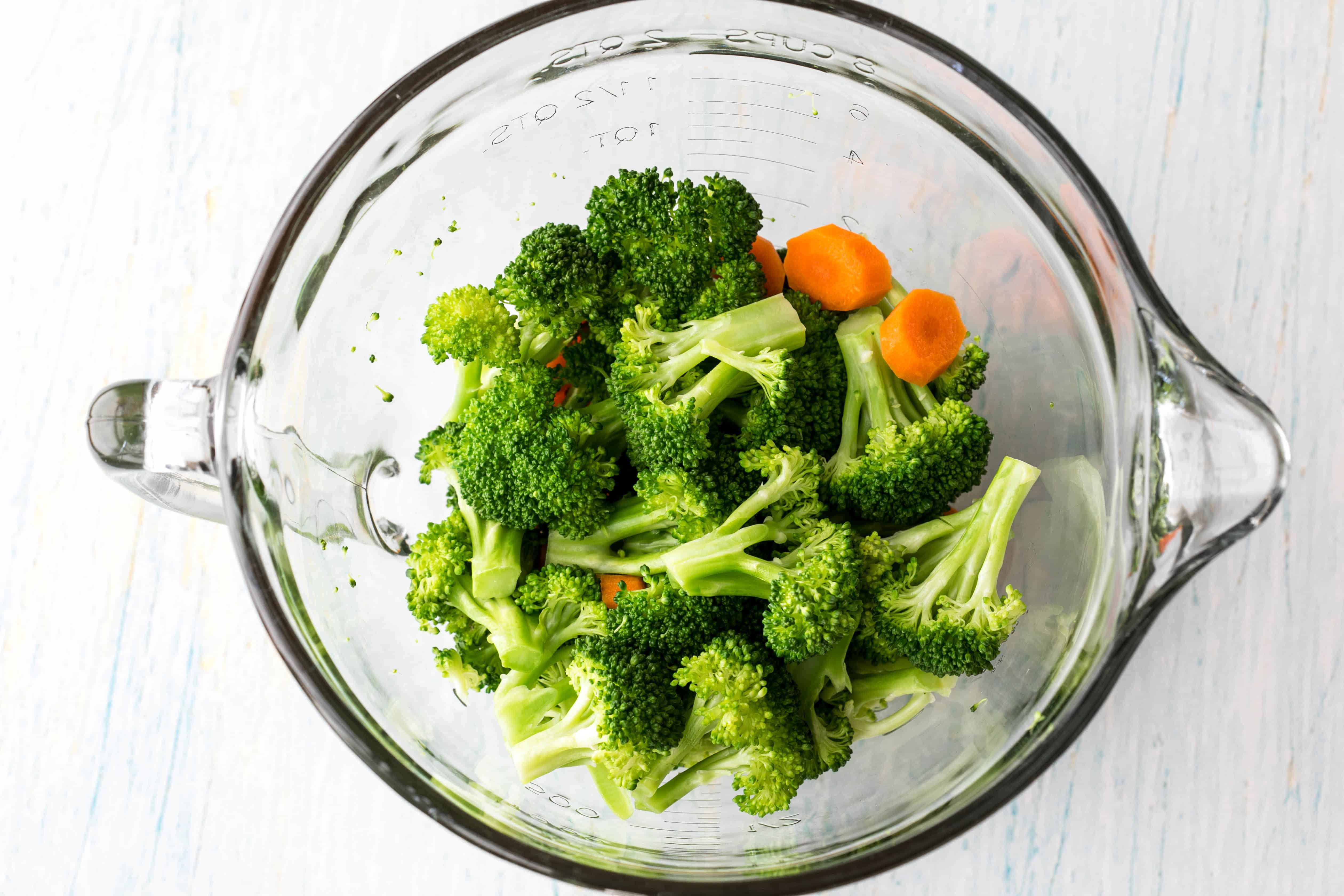 steamed broccoli and carrots in a glass bowl