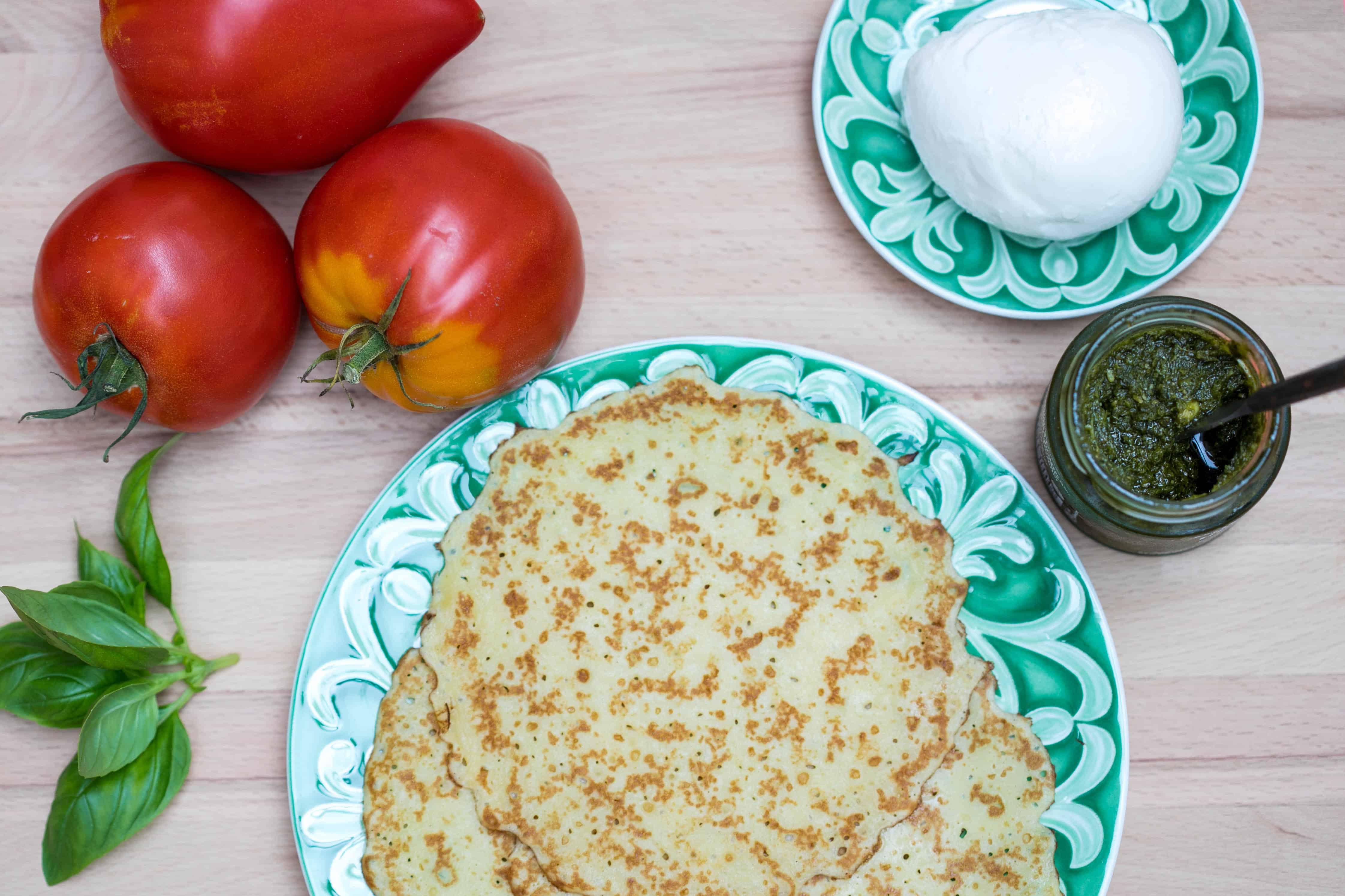 tomatoes, basil, crepes, mozzarella cheese, and pesto