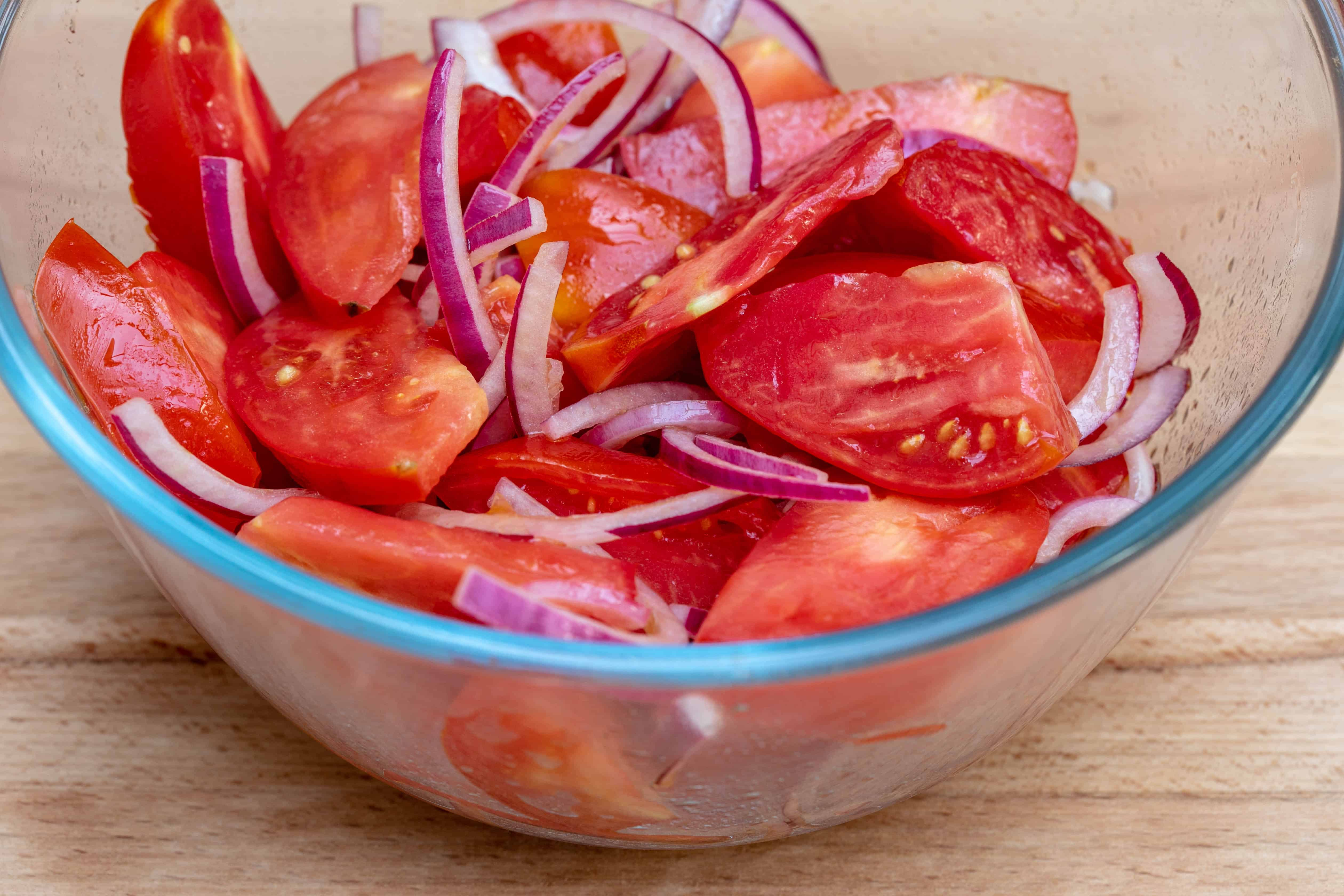 bowl of tomato wedges and red onion slices