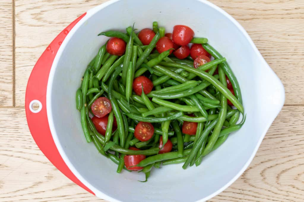 bowl of green beans and tomatoes in cider vinaigrette