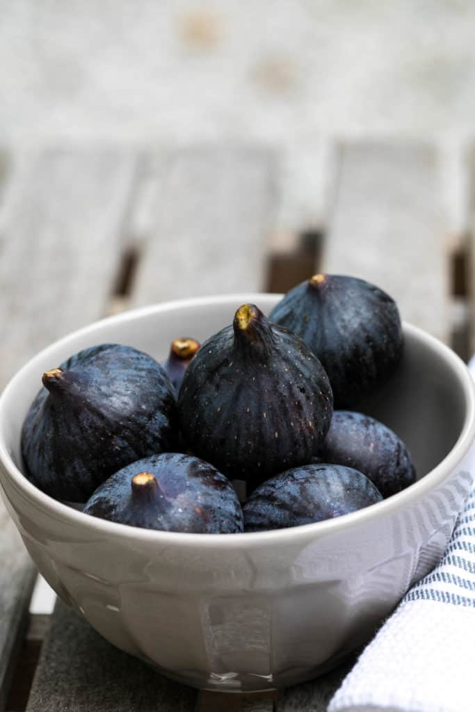 bowl of fresh figs on wooden table