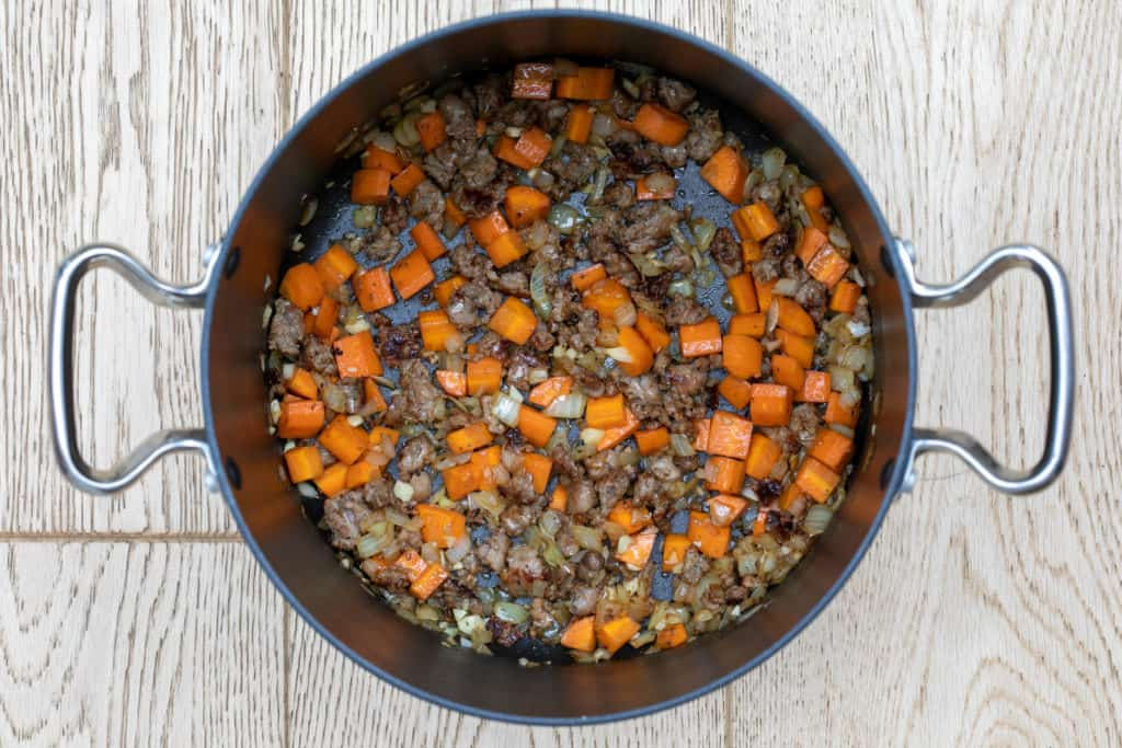 sausage, carrots, onion, and garlic sautéed in large pot