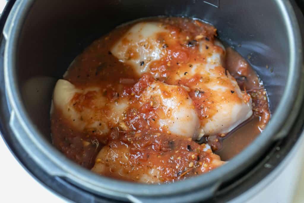 chicken breasts in salsa in slow cooker