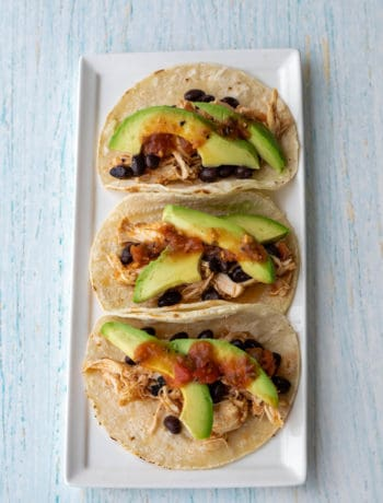 5-ingredient slow cooker chicken tacos on a rectangular white plate
