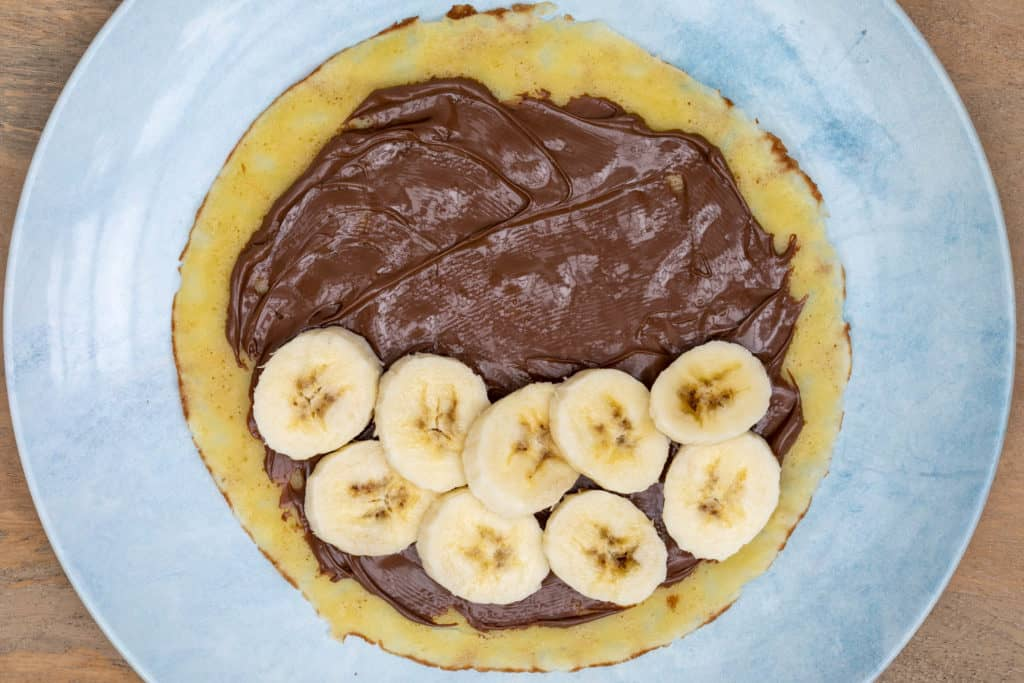 crepe spread with nutella and sliced bananas