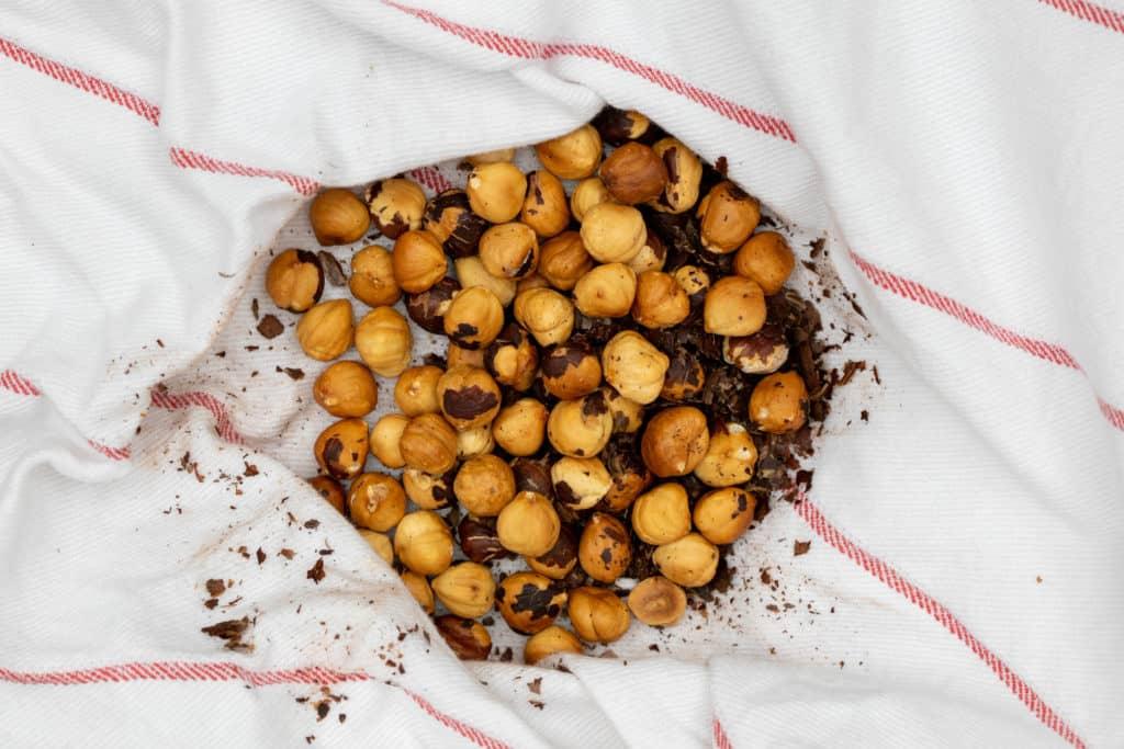 peeled hazelnuts in kitchen towel