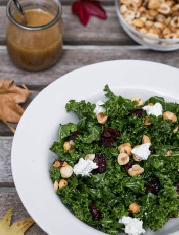 kale salad with cranberries, goat cheese, and hazelnuts with red wine vinaigrette and bowl of chopped hazelnuts