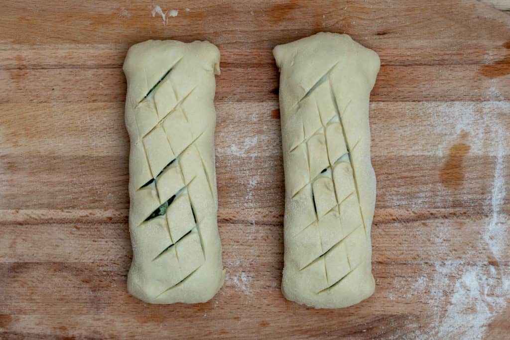 2 salmon wellington puff pastry packets scored