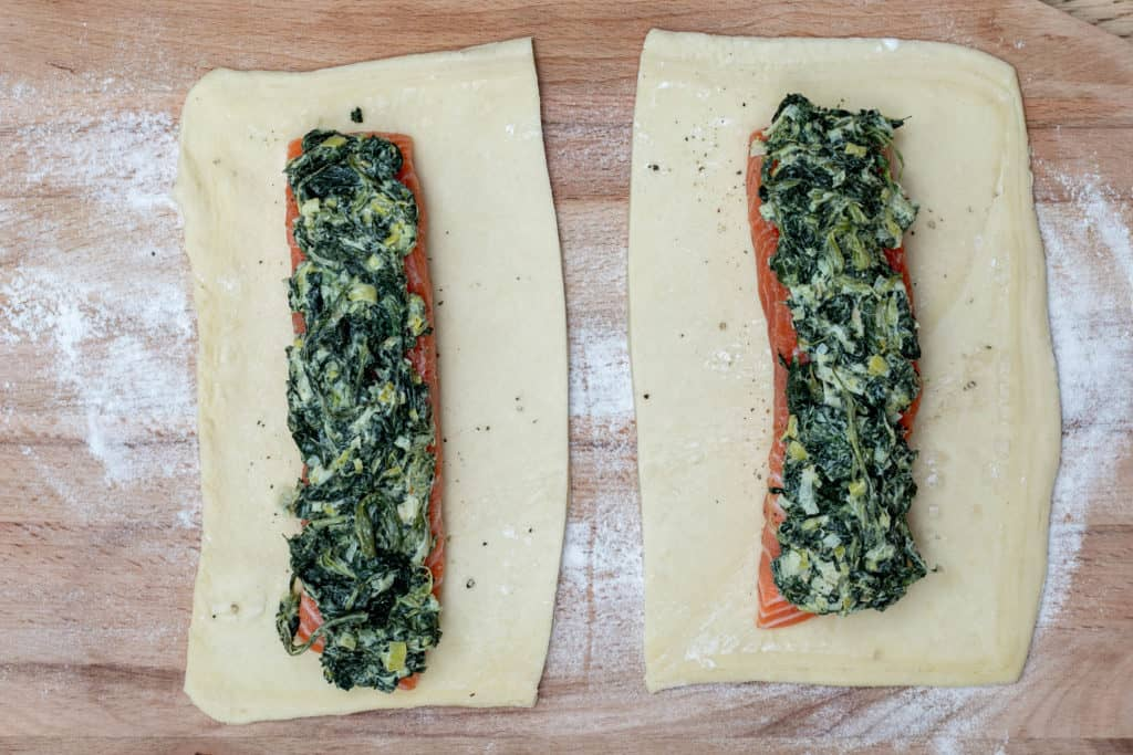 salmon on puff pastry with creamed leeks and spinach on top
