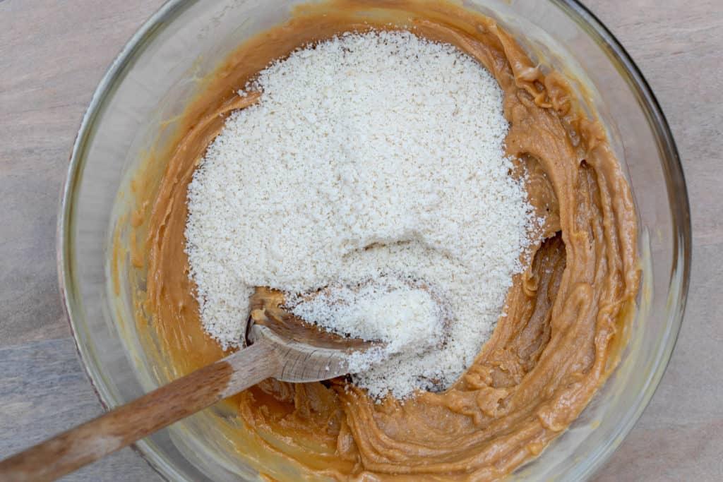 stirring almond flour into peanut butter dough