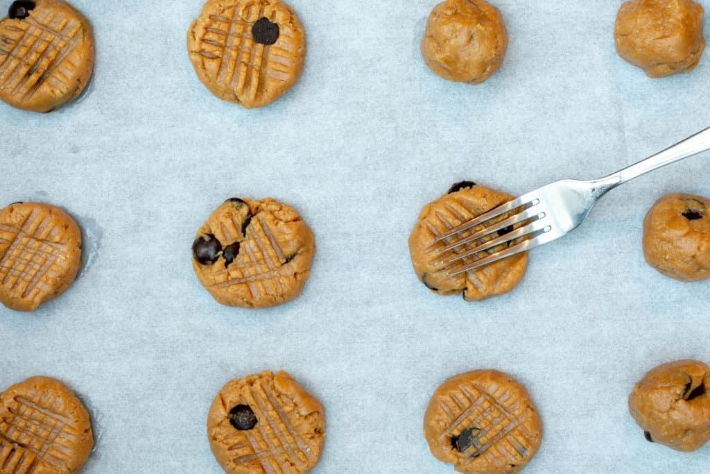 almond flour peanut butter cookies on sheet pan with cross-hatching