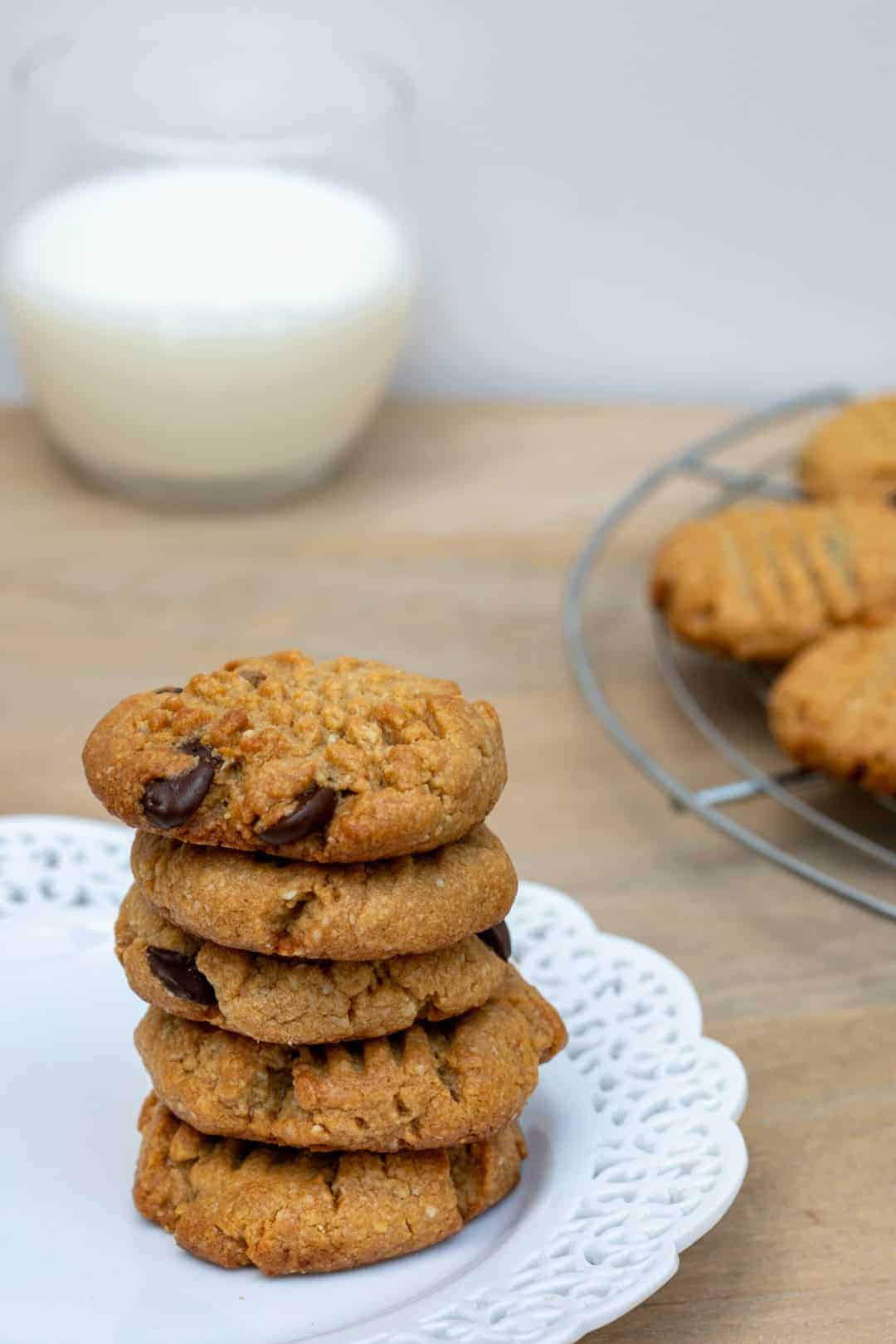 almond flour peanut butter cookies on a plate with milk in background