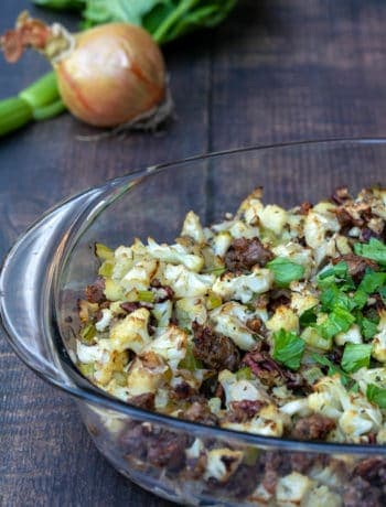 cauliflower stuffing with sausage and pecans in baking dish