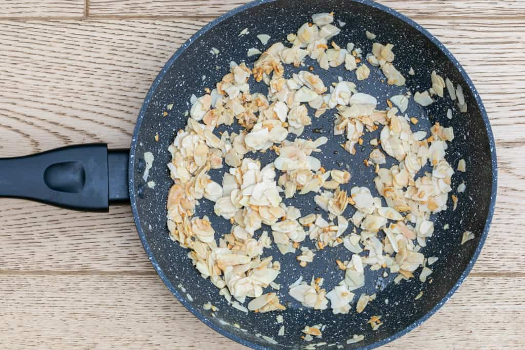 toasted almonds and garlic in skillet
