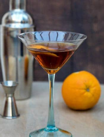 hanky panky cocktail with shaker and orange in background