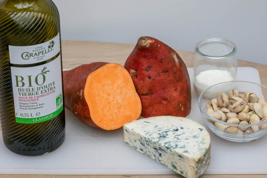 ingredients for sweet potato au gratin: sweet potatoes, olive oil, blue cheese, pistachios, cream
