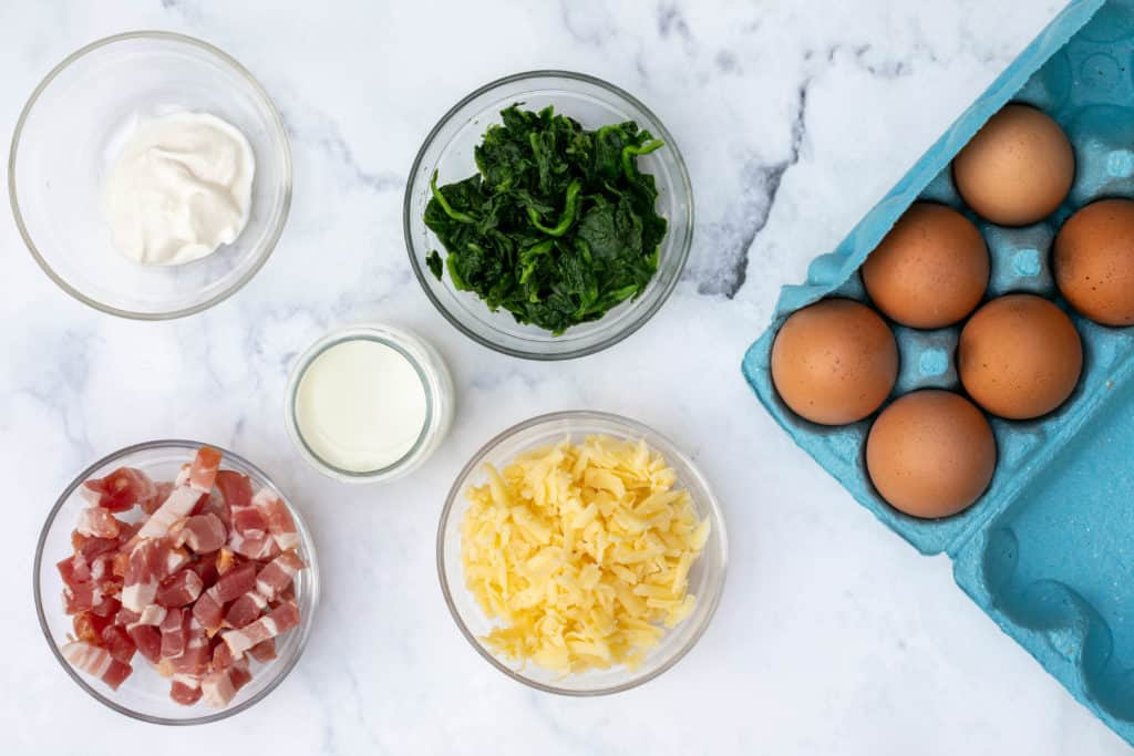 ingredients for spinach bacon egg cups: creme fraiche, spinach, eggs, lardons, milk, cheese