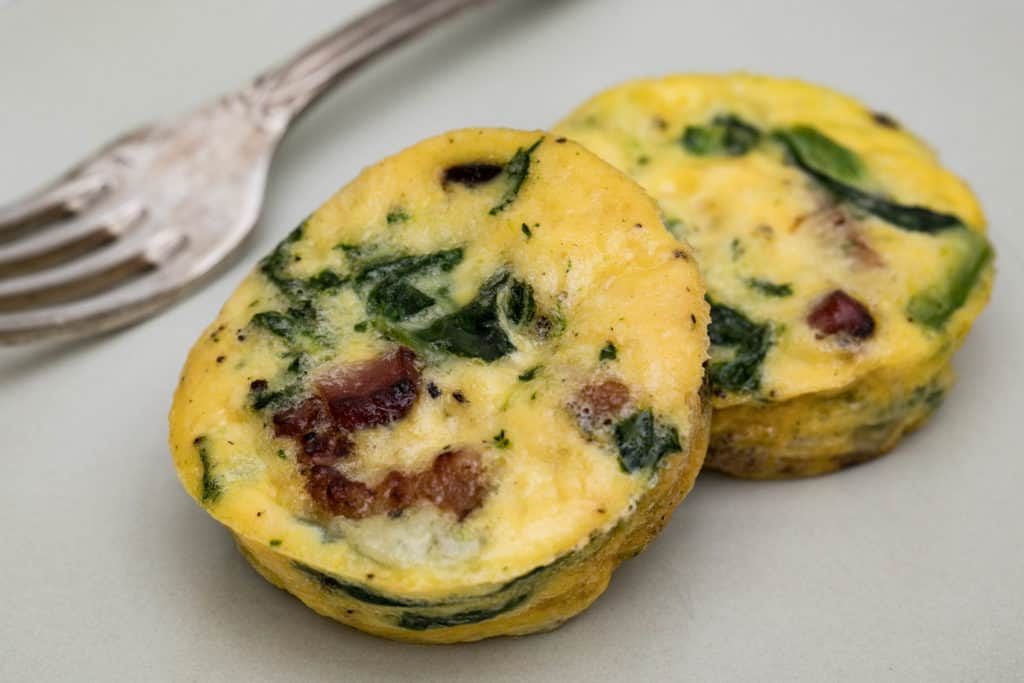 close up of spinach bacon egg cups