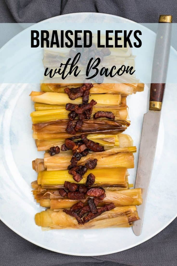 Braised Leeks with Crispy Bacon is a wonderful spring or fall side dish with just four ingredients. Leeks are braised in white wine and broth, then topped with crispy bacon bits. #leeks #braisedleeks #springrecipes #fallrecipes #bacon #holidaysidedishes #glutenfree