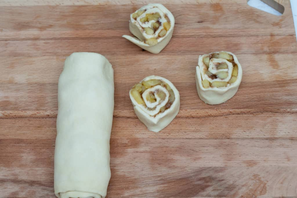 puff pastry filled with butter, cinnamon-sugar, and apples rolled into jelly roll and sliced