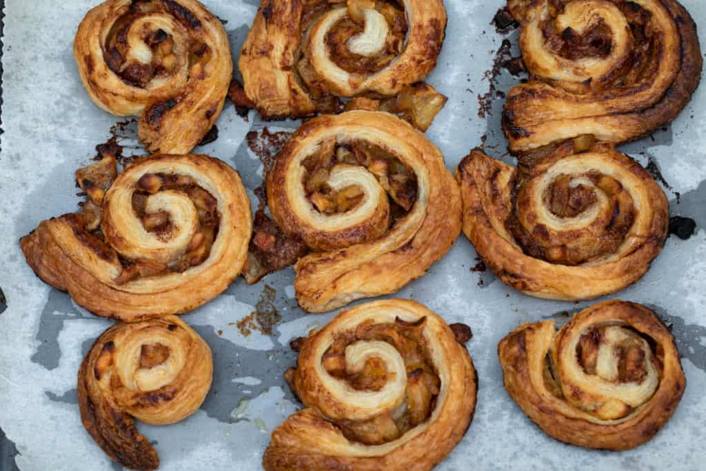 Baked puff pastry cinnamon rolls with apple