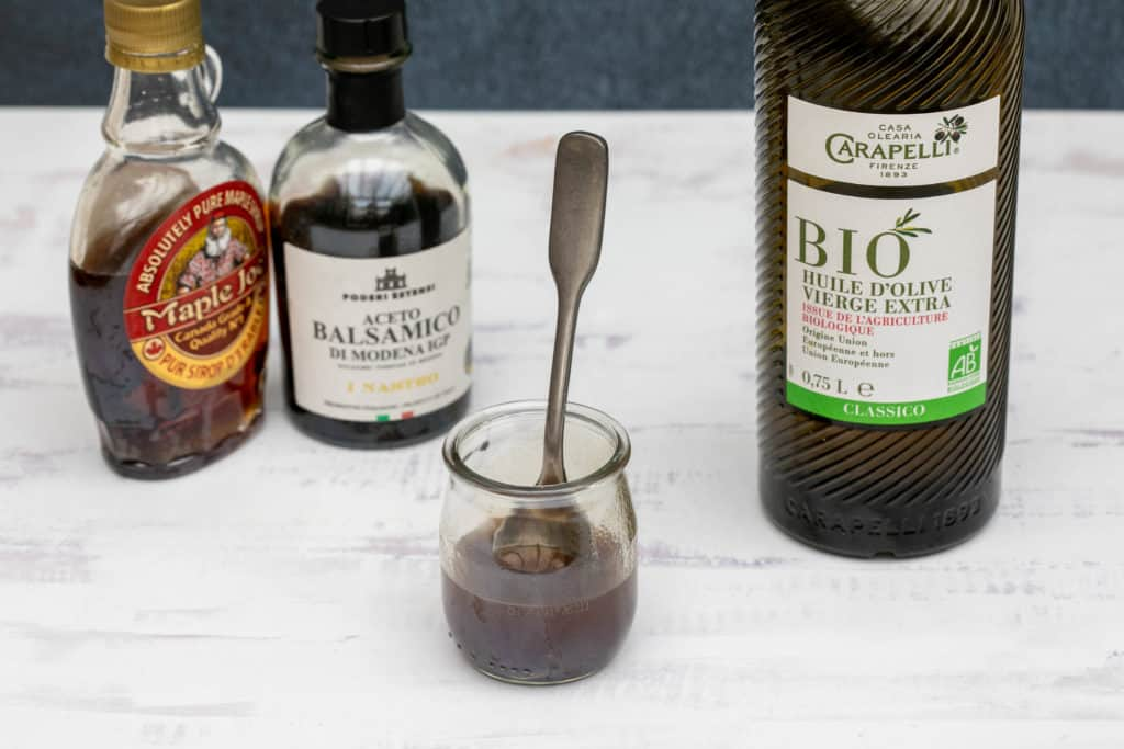 ingredients for balsamic vinaigrette: olive oil, maple syrup, balsamic vinegar