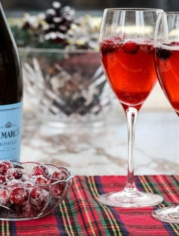 cranberry mimosas with prosecco and bowl of sugared cranberries