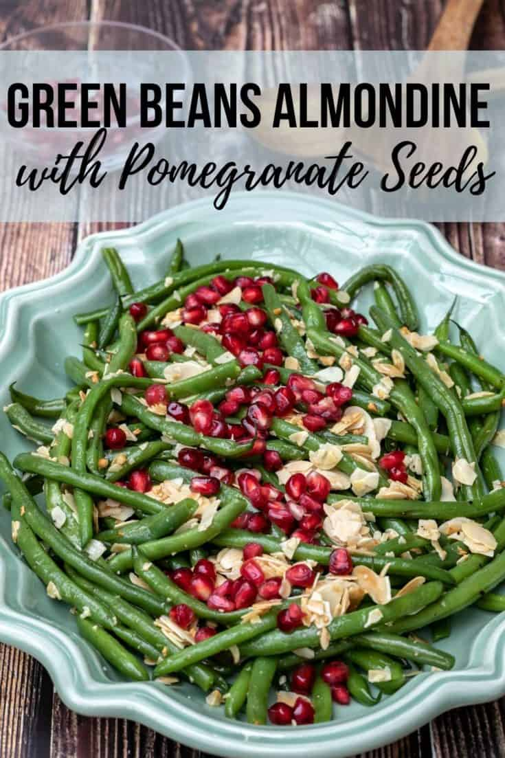 Green Beans Almondine is a traditional French dish of green beans served with a buttery almond topping. Adding pomegranate seeds takes this over the top! #greenbeans #holidaysides