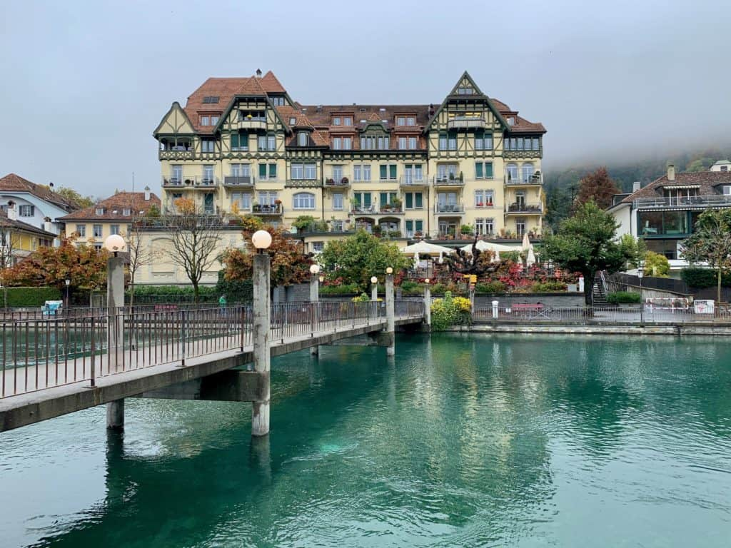 view of Thun bridge over river and city building