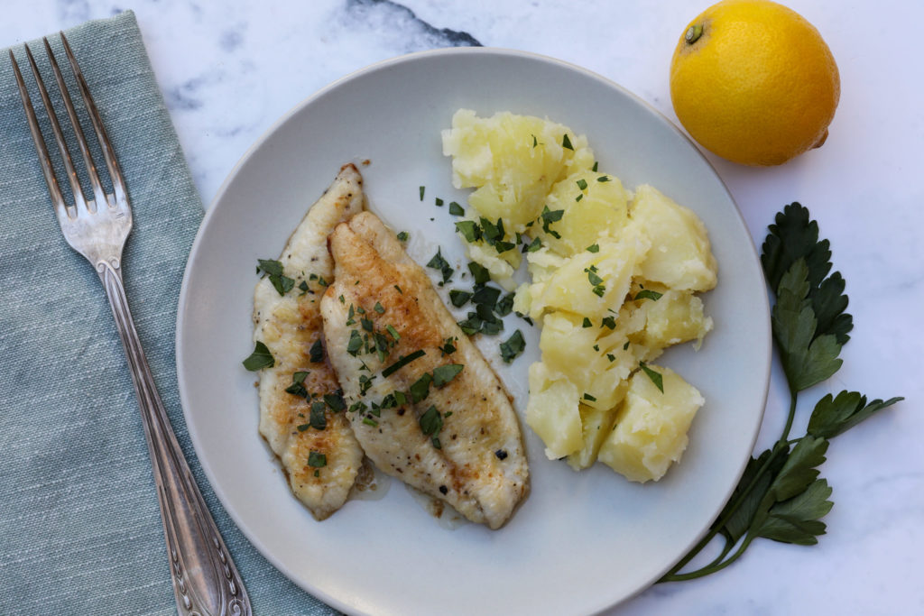 Plate of sole meuniere with potatoes with lemon and parsley