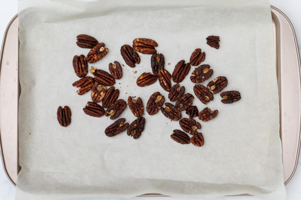 Pecans toasted on baking sheet