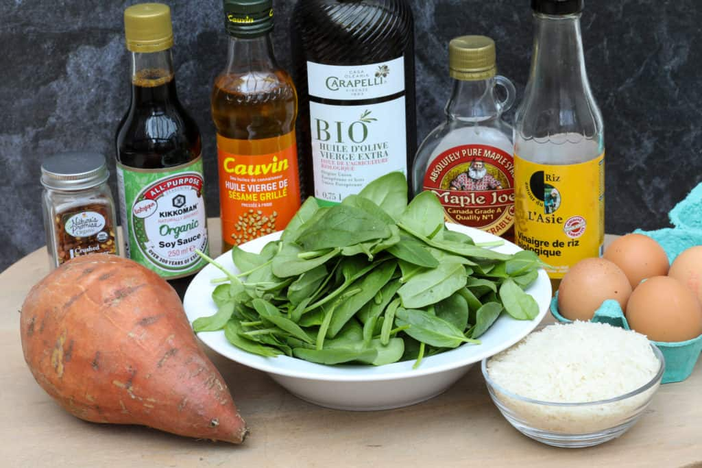Ingredients for ramen egg rice bowl, including eggs, spinach, sweet potato, and rice