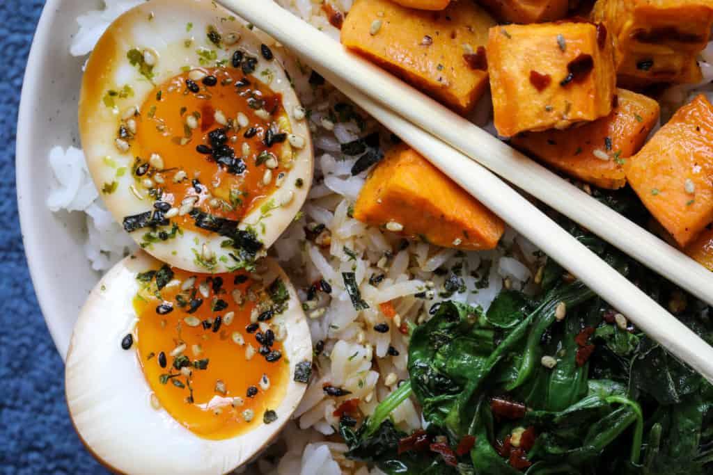 Close up of ramen egg rice bowl