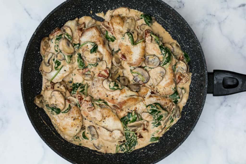 Creamy parmesan garlic mushroom chicken in large skillet