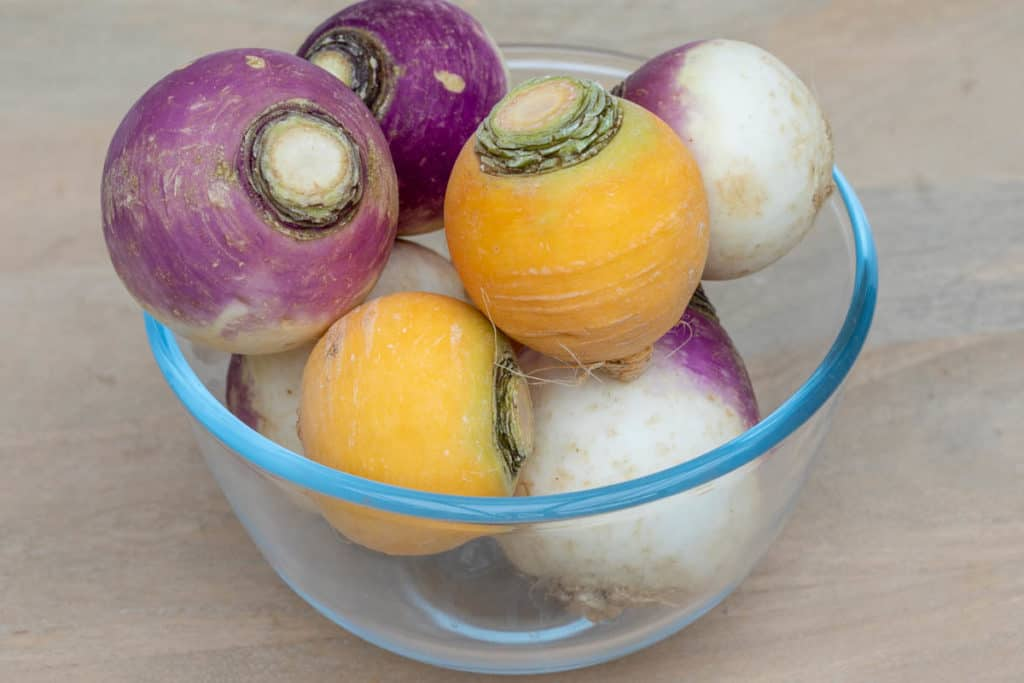 bowl of purple top and yellow turnips