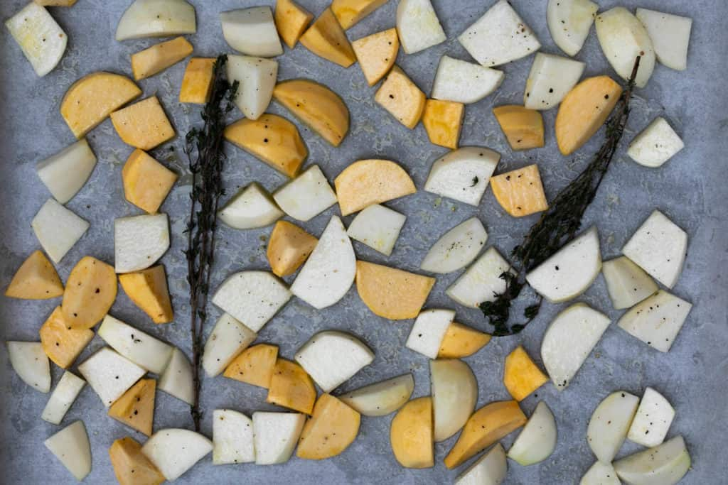 chopped turnips tossed with olive oil, honey, and thyme on sheet pan