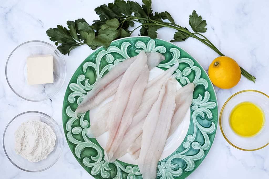 Ingredients for sole meuniere: sole, lemon, olive oil, flour, butter, parsley